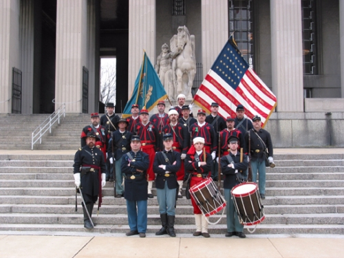 "Members of the St. Louis-based 3rd Missouri Volunteer Infantry Civil War reenactment group gather for a group photograph. Many of the group's members wear the traditional European ""Zouave"" uniform. During the Civil War, Pekin historian William H. Bates served in the 8th Missouri Infantry, also a Zouave regiment. In the front row at the left is Ulysses S. Grant impersonator Stan Prater."